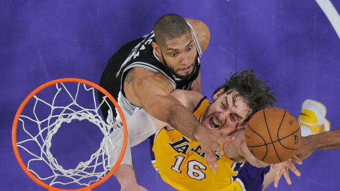 Los Angeles Lakers forward Pau Gasol, right, of Spain, and San Antonio Spurs forward Tim Duncan battle for a rebound during the second half in Game 3 of a first-round NBA basketball playoff series, Friday, April 26, 2013, in Los Angeles. The Spurs won 120-89. (AP Photo/Mark J. Terrill)