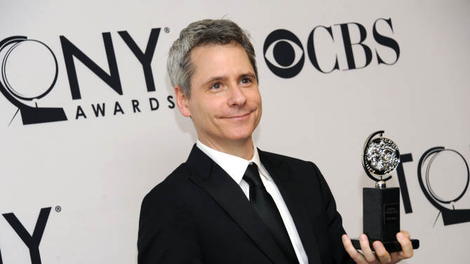 """FILE - In this June 10, 2012 file photo, Bruce Norris poses with his Best Play award for """"Clybourne Park"""" in the press room at the 66th annual Tony Awards, in New York. The Pulitzer Prize-winning playwright of """"Clybourne Park"""" says he withdrew permission for a Berlin theater company to produce the play after learning that one of the actors would perform the roles in blackface. (Photo by Evan Agostini /Invision/AP, File)"""
