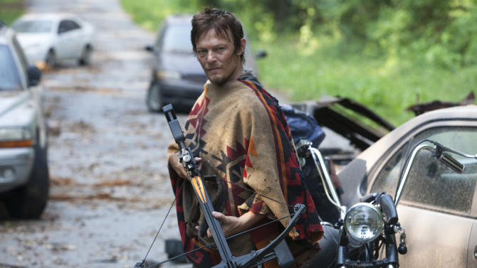 """This undated publicity photo provided by AMC shows Norman Reedus as Daryl Dixon in a scene from AMC's TV show, """"The Walking Dead,"""" Season 3, Episode 5. The show airs Sundays at 9 p.m. EST on AMC. (AP Photo/AMC, Russell Kaye)"""