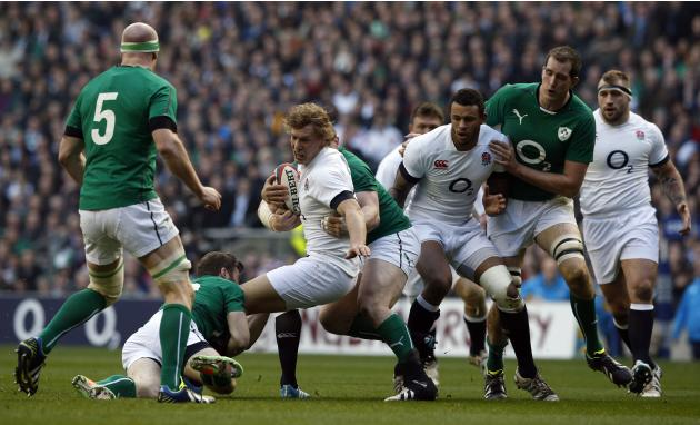 England's Billy Twelvetrees (centre) is tackled during the Six Nations Rugby Union International match between England and Ireland at Twickenham Stadium, in west London, Saturday Feb. 22, 2014. (A