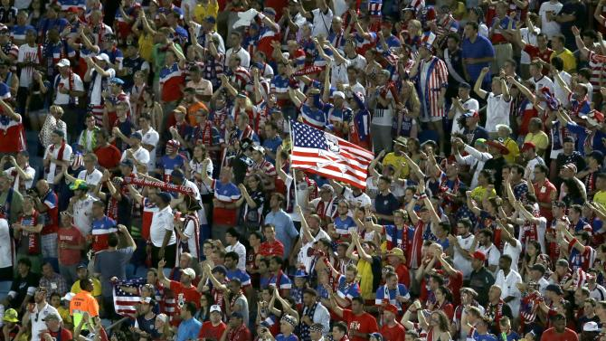 Fans wave a United States' flag during the group G World Cup soccer match between Ghana and the United States at the Arena das Dunas in Natal, Brazil, Monday, June 16, 2014. (AP Photo/Hassan Ammar)