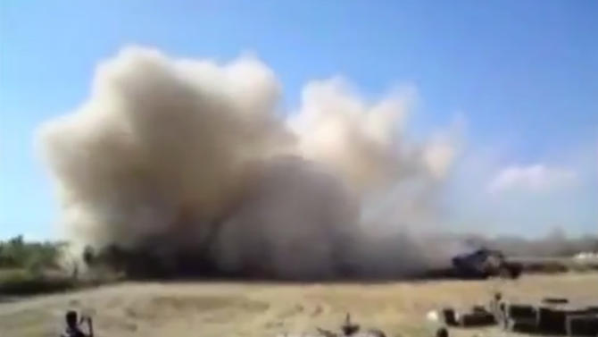 In this image taken from leaked video obtained by Ugarit News and posted on Monday, July 15, 2013, which has been authenticated based on its contents and other AP reporting, purports to show forces loyal to President Bashar Assad firing rockets into Homs, Syria. After seizing the momentum in recent months in Syria's civil war, President Bashar Assad's forces are on the offensive against the rebels on several fronts, including in Idlib province along the border with Turkey. Government forces are in firm control of the provincial capital of same name, while dozens of rebel brigades control the countryside.(AP Photo/Ugarit News via AP video)