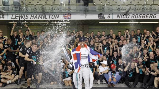 Mercedes Formula One driver Lewis Hamilton of Britain celebrates with his team after winning the Abu Dhabi F1 Grand Prix at the Yas Marina circuit in Abu Dhabi