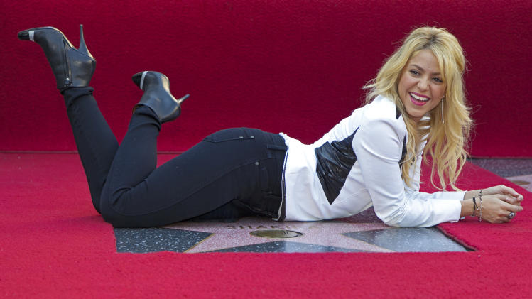 Colombian singer Shakira poses as she is honored with a star on the Hollywood Walk of Fame in Los Angeles on Tuesday, Nov. 8, 2011. (AP Photo/Damian Dovarganes)