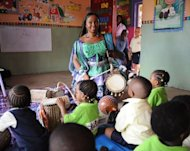 "Talking drummer Aralola Olamuyiwa, popularly known as Ara, teach children how to play the talking drum in a private school in Lagoson. She visits schools teaching children to play, calling it ""a way of preserving our heritage through our children who are going to be our tomorrow, our future."""