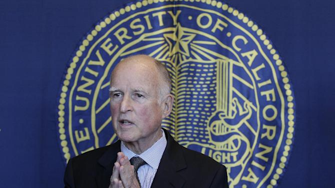 Gov. Jerry Brown speaks to reporters after attending a University of California Board of Regents meeting in San Francisco, Wednesday, Nov. 14, 2012. (AP Photo/Jeff Chiu)