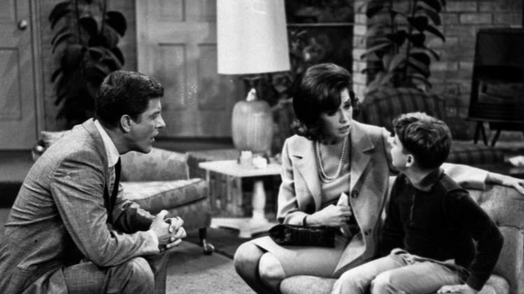 "FILE - In this 1965 file photo, Dick Van Dyke, left, and Mary Tyler Moore talk to Larry Matthews, who plays their son, on ""The Dick Van Dyke Show."" Van Dyke is the recipient of the Life Achievement Award at the upcoming 19th Annual SAG Awards ceremony on Sunday, Jan. 27, 2013. (AP Photo, File)"