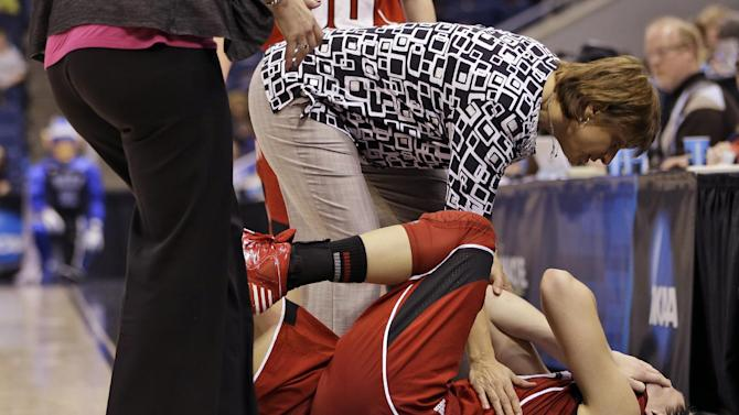 Nebraska head coach Connie Yori tends to forward Jordan Hooper after Hooper suffered an injury during the second half of a regional semifinal in the women's NCAA college basketball tournament against Duke, Sunday, March 31, 2013, in Norfolk, Va. (AP Photo/Steve Helber)