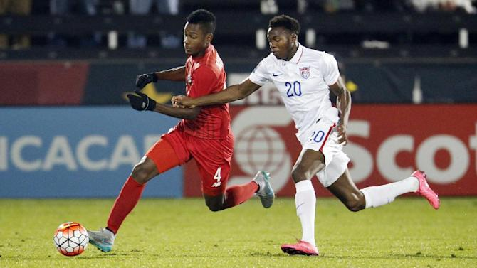 Panama defender Michael Murillo, left, moves ball down the field past USA midfielder Gboly Ariyibi during the first half of a CONCACAF men's Olympic qualifying soccer match Tuesday, Oct. 6, 2015, in Commerce City, Colo. (AP Photo/David Zalubowski)