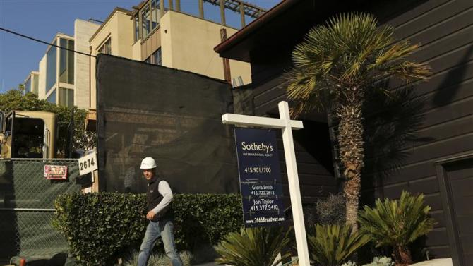 A construction worker walks at a home for sale in the Pacific Heights neighborhood in San Francisco