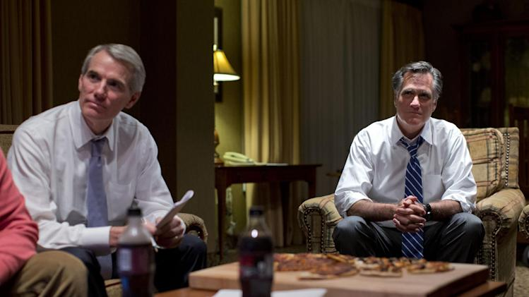 Republican presidential candidate, former Massachusetts Gov. Mitt Romney, right, watches the vice presidential debate with Sen. Rob Portman, R- Ohio, left, in his hotel room on Thursday, Oct. 11, 2012 in Asheville, N.C.  (AP Photo/ Evan Vucci)