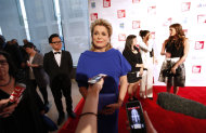 Actress Catherine Deneuve is interviewed as she arrives for the Film Society of Lincoln Center&#39;s 39th annual Chaplin Award Gala at Alice Tully Hall, Monday, April 2, 2012 in New York. (AP Photo/Jason DeCrow)