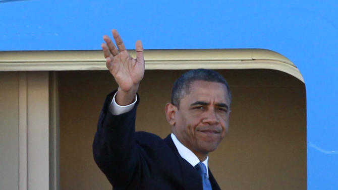 President Barack Obama waves as he boards Air Force One before departing the Orlando International Airport, Monday, Oct. 29, 2012, in Orlando, Fla., enroute to Washington to monitor Hurricane Sandy.  (AP Photo/John Raoux