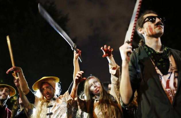 Israelis dressed as zombies take part in an annual Zombie Walk procession for the Jewish holiday of Purim in Tel Aviv