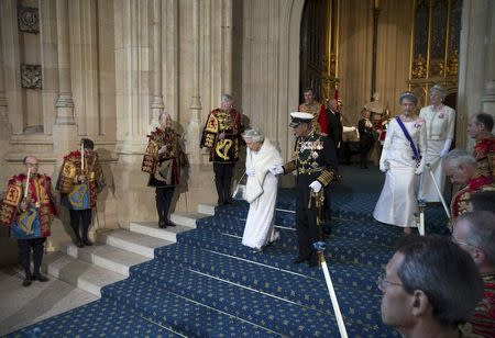 Britain's Queen Elizabeth and Prince Philip leave after the State Opening of Parliament at the Palace of Westminster in central London