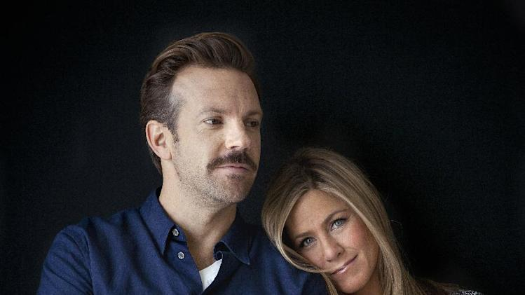"FILE - In this July 27, 2013 file photo, actor Jason Sudeikis, left, and actress Jennifer Aniston pose for a portrait as they promote the movie ""We're the Millers"" in New York. The film opens nationwide on Wednesday, Aug. 7. (Photo by Carlo Allegri/Invision/AP, File)"