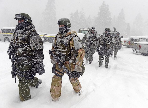 A San Bernardino County Sheriff SWAT team returns to the command post at Bear Mountain near Big Bear Lake, Calif. after searching for Christopher Jordan Dorner on Friday, Feb. 8, 2013. Search conditio
