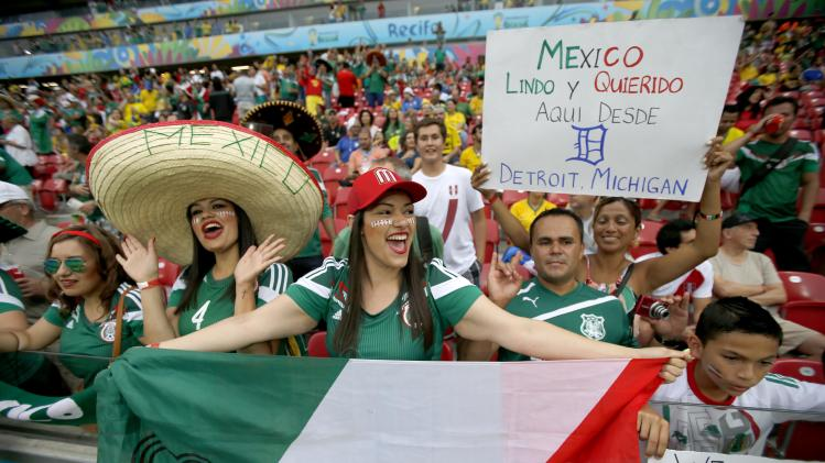 Mexico fans cheer prior to the group A World Cup soccer match between Croatia and Mexico at the Arena Pernambuco in Recife, Brazil, Monday, June 23, 2014