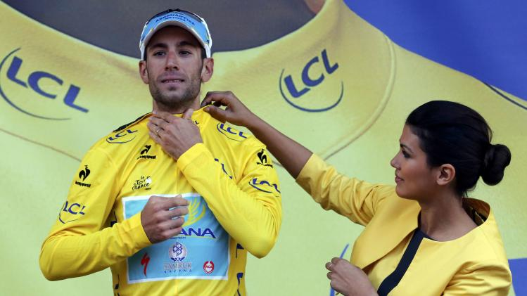 Astana team rider Nibali of Italy puts on his leader's yellow jersey on the podium of the 161.5-km tenth stage of the Tour de France cycling race