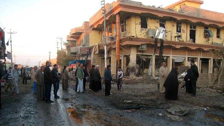 Local residents at the site of a bomb attack in Tuz Khurmatu, northern Iraq, on November 24, 2013