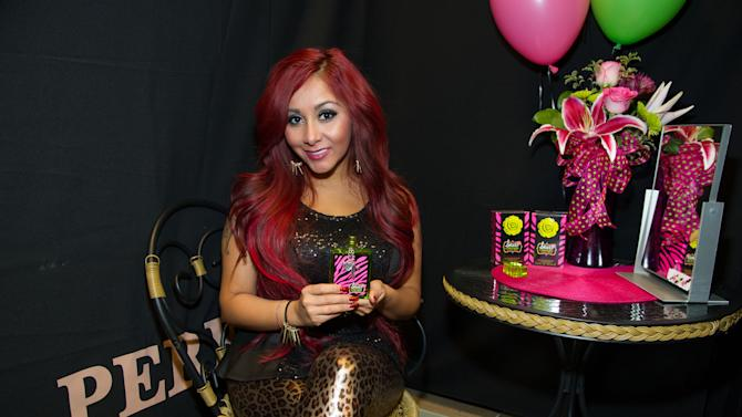 "Nicole ""Snooki"" Polizzi poses for a photo before a meet and greet at a Perfumania for the release of her second fragrance, ""Snooki Couture"" on Wednesday, January 9, 2013, in Las Vegas, NV (Photo by Al Powers/Powers Imagery/Invision/AP)"