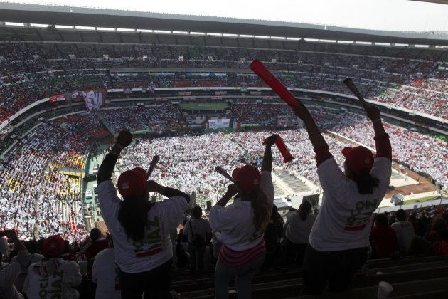 Supporters of Enrique Pena Nieto, presidential candidate of the opposition Institutional Revolutionary Party, PRI, cheer during a campaign rally at Azteca stadium in Mexico City, Sunday, June 24, 2012. General elections in Mexico are scheduled for Sunday, July 1. (AP Photo/Esteban Felix)
