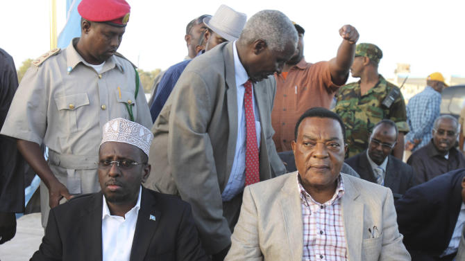Somali president Sharif Sheik Ahmed, left, and UN envoy for Somalia Augostina Mahiga, right, during the swearing in ceremony of 211 MP's at Aden Ade international airport in Mogadishu, Somalia, Monday, Aug 20, 2012.  Somalia's newly-selected members of parliament were on Monday sworn in as the Horn of Africa country moves from the long-drawn transitional period to a permanent form of government. (AP Photo/Farah Abdi Warsamehmeh)