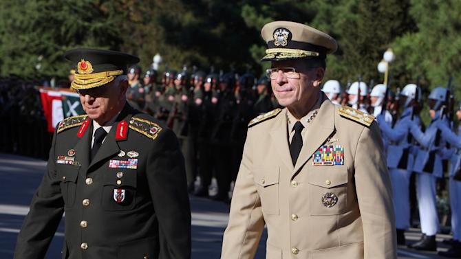FILE - In this Sept. 3, 2010 file photo, Chairman of the U.S. Joint Chiefs Adm. Mike Mullen, right, and Turkey's Chief of Staff Gen. Isik Kosaner inspect a guard of honour at the Turkish army headquarters in Ankara, Turkey. Gen. Kosaner and top army commanders have resigned Friday, July 29, 2011, in what is seen as tensions with the Islamic-rooted government.(AP Photo/Burhan Ozbilici, File)