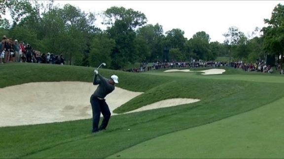 Woods approach on No. 13 in Round 2 of the Memorial