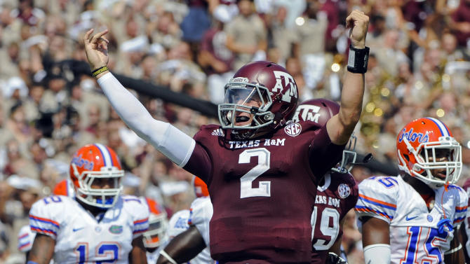 FILE - In this Sept. 8, 2012 file photo, Texas A&M's Johnny Manziel (2) reacts after a touchdown run during the second quarter of an NCAA college football game against Florida in College Station, Texas. Manziel could become the first freshman to win the Heisman Trophy when the award is presented Saturday, Dec. 8, 2012, in New York. (AP Photo/Dave Einsel, File)