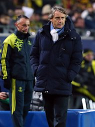 DORTMUND, GERMANY - DECEMBER 04:  Roberto Mancini, head coach of Manchester reacts during the UEFA Champions League group D match between Borussia Dortmund and Manchester City at Signal Iduna Park on December 4, 2012 in Dortmund, Germany.  (Photo by Martin Rose/Bongarts/Getty Images)
