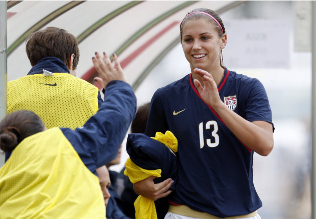 U.S. player Alex Morgan is greeted by teammates on the bench after being substituted during their Algarve Cup women's soccer match with Finland Monday, March 7 2011, in Quarteira, Portugal. Morgan sco
