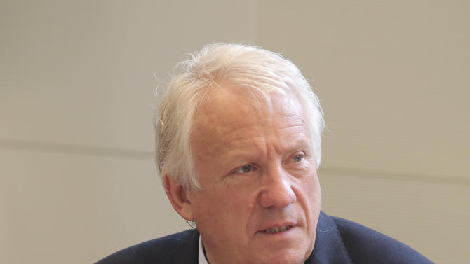 FIA Formula One Race Director, Charlie Whiting, prior to the hearing at the FIA headquarters in Paris, Thursday, June 20, 2013. The hearing to determine whether Mercedes and Pirelli broke Formula One rules by holding in-season tire tests has opened in Paris.  The International Automobile Federation (FIA) convened the international tribunal hearing to determine whether Mercedes gained a competitive advantage from the testing session in Barcelona last month.  (AP Photo/Michel Euler, Pool)