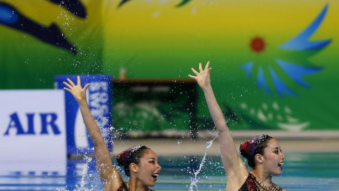 Japan's Yukiko Inui and Risako Mitsui perform during their women's duet synchronised swimming competition at Munhak Park Tae-hwan Aquatics Center during the 17th Asian Games in Incheon