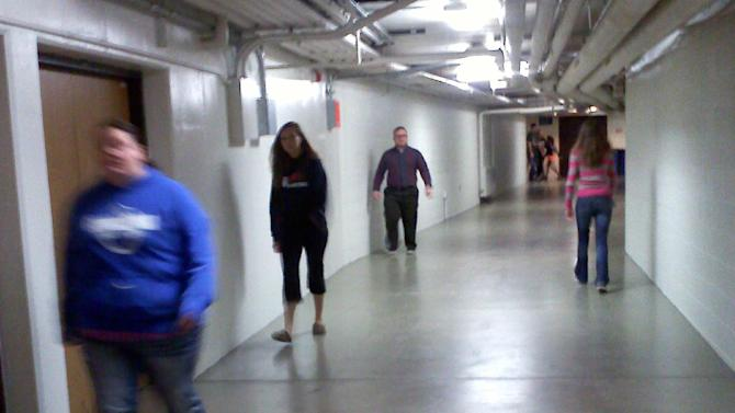 Students walk in tunnels connecting dorms to academic buildings at Concordia University Wisconsin Tuesday, Jan. 28, 2014 in Mequon, Wis. While many Midwestern college students pile on layers to brave the frigid walk to classes in subzero weather, those attending Concordia on the windy shores of Lake Michigan can leave their coats in their dorms and take a much cozier trek using the schools 4 miles of connecting tunnels and hallways. (AP Photo/Gretchen Ehlke)