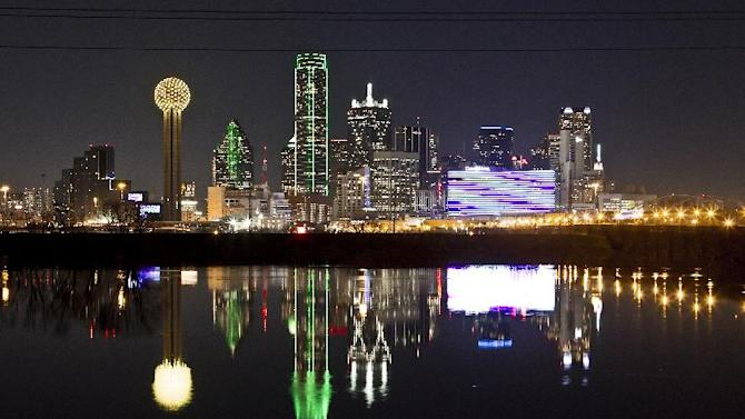 In this Thursday, Jan. 26, 2012 file photo, the Dallas skyline is reflected in the Trinity River in Dallas. (AP Photo/Brandon Wade)