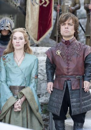 """In this publicity photo provided by HBO, Lena Headey as Cersei Lannister, left, and Peter Dinklage as Tyrion Lannister, are shown in a scene from HBO's """"Game of Thrones,"""" Season 2, in Dubrovnik, Croatia. (AP Photo/HBO, Paul Schiraldi)"""