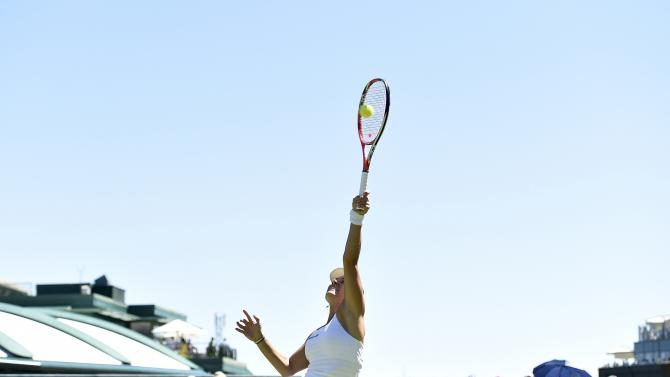 Angelique Kerber of Germany plays a overhead smash during her match against Carina Witthoeft of Germany at the Wimbledon Tennis Championships in London