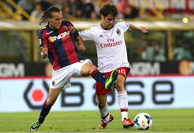 AC Milan midfielder Andrea Poli, left, and Bologna midfielder Diego Laxalt, of Uruguay, vie for the ball during a Serie A soccer match at Bologna's Renato Dall'Ara stadium, Italy, Wednesday, Sept. 25,