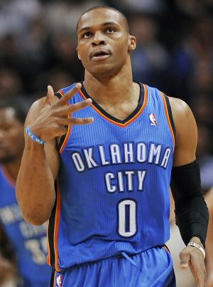 Oklahoma City Thunder guard Russell Westbrook celebrates a 3-point basket during the first half of an NBA basketball game against the San Antonio Spurs, Saturday, Dec. 21, 2013, in San Antonio. (AP Photo/Darren Abate)