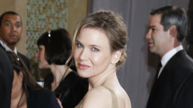 Actress Renée Zellweger arrives at the Oscars at the Dolby Theatre on Sunday Feb. 24, 2013, in Los Angeles. (Photo by Todd Williamson/Invision/AP)