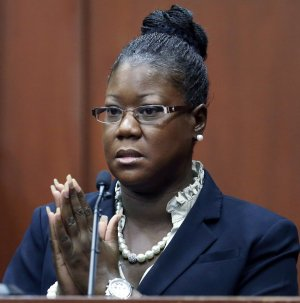 Trayvon Martin's mother, Sybrina Fulton, takes the …