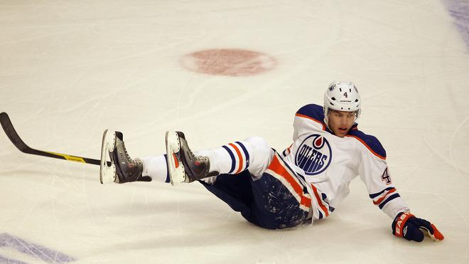 Taylor Hall #4 Of The Edmonton Oilers Slides Getty Images