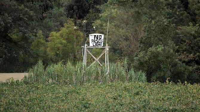 "In this May 23, 2013 photo, a water tank displays a message that reads; ""No Pascua-Lama"" in El Corral, a small town of about 200 inhabitants, mostly from the Diaguita ethnic group, near the facilities of Barrick Gold Corp's Pascua-Lama project in northern Chile. The Diaguitas live in the foothills of the Andes, where for as long as anyone can remember they've drunk straight from the glacier-fed river that irrigates their orchards and vineyards with clean water. But since the Barrick gold mine project moved in, residents claim the river levels have dropped and some complain of cancerous growths and aching stomachs. (AP Photo/Jorge Saenz)"