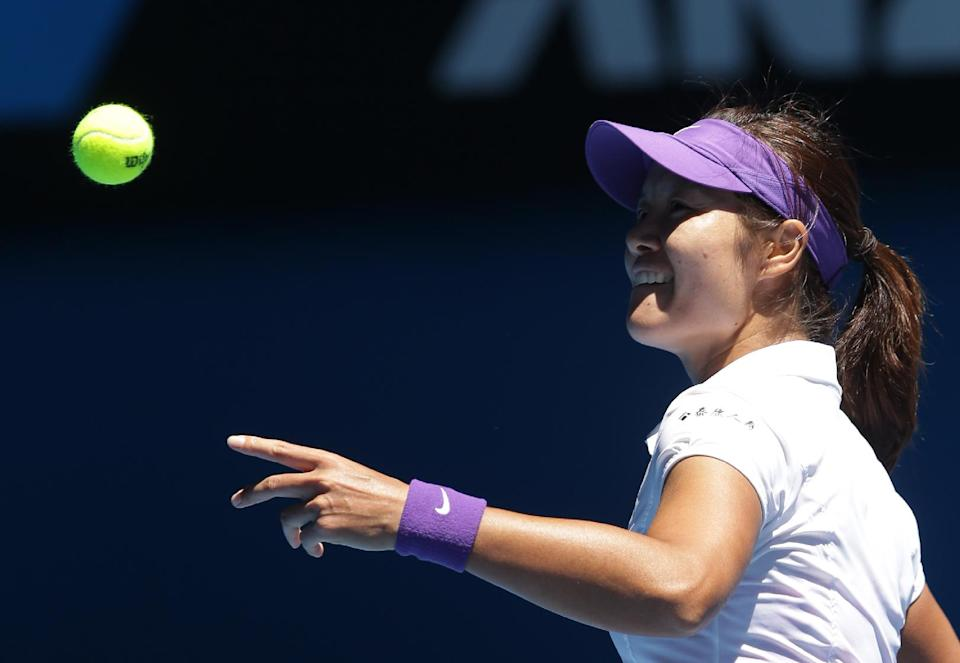 China's Li Na prepares to hit the ball out of the court as she celebrates her win over Poland's Agnieszka Radwanska in their quarterfinal match at the Australian Open tennis championship in Melbourne, Australia, Tuesday, Jan. 22, 2013. (AP Photo/Dita Alangkara)
