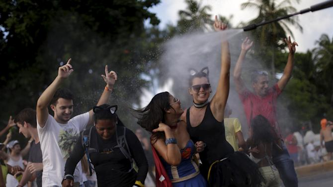 Revellers attend a carnival party in a neighborhood in Olinda