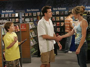"Jake (Angus T. Young) gives Charlie (Charlie Sheen) a hard time when he tries to hit on a woman CBS' ""Two and a Half Men"""