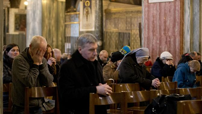 People pray during a Mass at Westminster Cathedral, in London, which is the Mother Church for Roman Catholics in England and Wales, Monday, Feb. 11, 2013.  Pope Benedict XVI said Monday he lacks the strength to fulfill his duties and on Feb. 28 will become the first pontiff in 600 years to resign. The announcement sets the stage for a conclave in March to elect a new leader for the world's 1 billion Catholics.  (AP Photo/Matt Dunham)