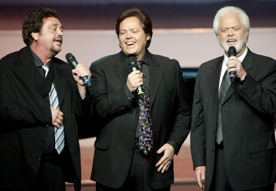 "From left, Jay Osmond,  Jimmy Osmond and Merrill Osmond sing at Andy Williams' memorial service at the Moon River Theater, in Branson, Mo., Sunday, Oct. 21, 2012. Williams, known for singing ""Moon River"" and his Christmas television specials, passed away Sept. 25. (AP Photo/Grant Hindsley)"