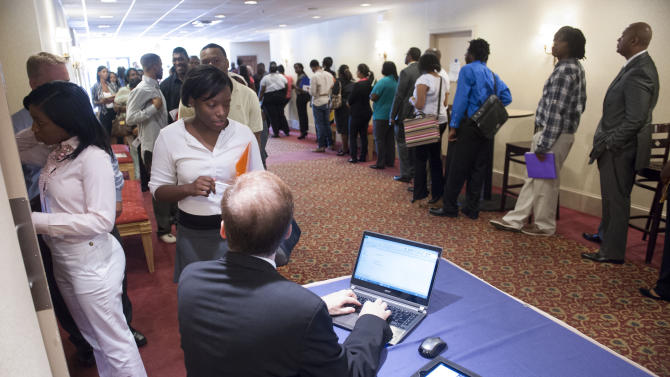 Job seekers line up to register to attend a job fair held in Atlanta, Thursday, May 30, 2013. The Labor Department reports on the number of Americans who applied for unemployment benefits for the first time last week, Thursday June 27, 2013. (AP Photo/John Amis)